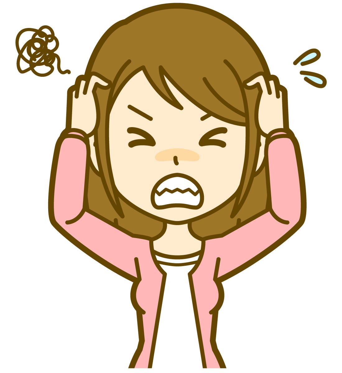 ストレスで歯を食いしばる女性
